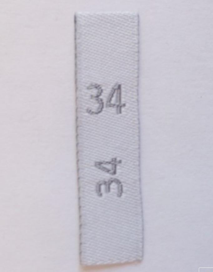 étiquette pour indiquer la taille des vêtements avec des chiffres : 34, 36, 38, ...